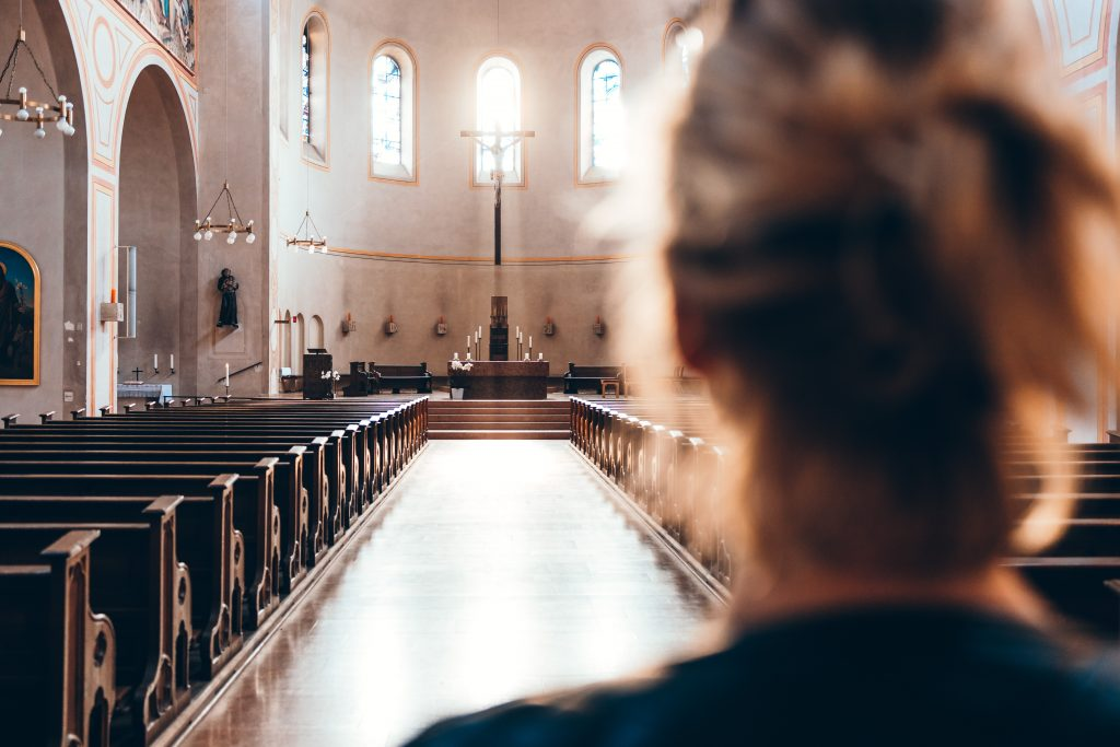 Girl entering the Church to pray