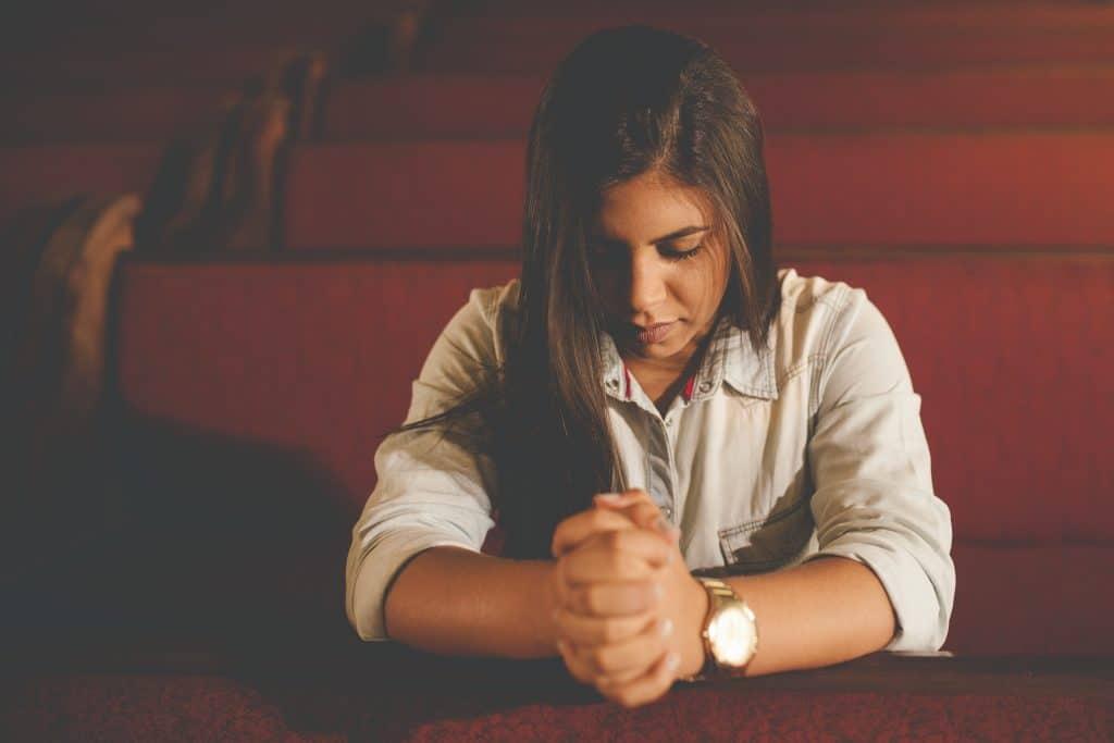 Girl praying in the church